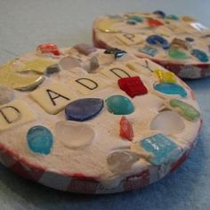 Pin It We like to make homemade, crafty gifts for the family and for this Father's Day, the kids made mosaic coasters. Materials: metal jar lids plaster of Paris sea glass, seashells, smooth pebbles, mosaic tiles, broken pottery, letter beads or tiles or scrabble tiles to spell names or words...