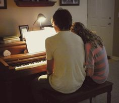 wow...so, give her straight hair and it's Christina and Nat at the piano when she's like 18 or 19.