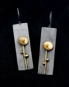 "Contemporary Jewelry Design by Andrea Williams: Kebyar Summer Drops: The Kebyar Summer Drop Earrings are hand fabricated from patinated  Reclaimed Sterling Silver & 18k gold. Kebyar is a Balinese word meaning ""the process of flowering"". These earrings are part of a series reflecting the seasons."