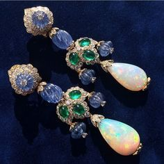 """Incredible work of art by #DavidWebb Mysterious opal along with carved sapphires and emeralds what a unique beautiful and unique piece …"""