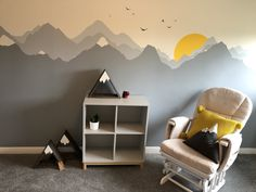 The nursery wall design was complemented with 'Snowy Peaks Shelves', 'Snowy Peaks Cushion' and a bunting with light grey and mustard colours by TiG KIDS. See more photos on this Board.