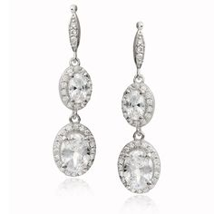 Add elegance with these chic sterling silver dangle earrings by Tressa Collection. These earrings feature shimmering pave-set and oval-cut cubic zirconia gemstones with a butterfly clasp to complete your look.
