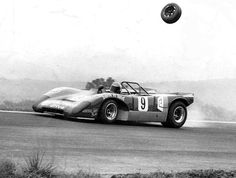 Lola T212-Roy Hesketh Circuit Racing Car Photo Gallery - Andre Verwey Springbok Series 3hr race 1971. Wheel from another car trying to overtake him.