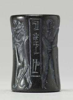 "Cylinder Seal with a Nude Hero : In the Akkadian period, seal designs became more detailed. In the two scenes on this seal, a heroic figure with heavy beard and long curls holds off two roaring lions, and another hero struggles with a water buffalo. The inscription in the panel identifies the owner of this seal as ""Ur-Inanna, the farmer."" Date	between 2350 and 2150 BC (Old Akkadian)"