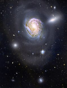 Spiral galaxy NGC 4911 in the Coma Cluster                                                                                                                                                                                       Name:NGC 4911 Type:• Solar System : Galaxy : Type : Spiral • X - Galaxies Images Distance:350 million light years Credit:  NASA, ESA, and the Hubble Heritage Team (STScI/AURA).