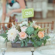 wooden basket, lined with lace and overflowing with lush florals and greenery