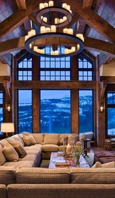 I could look at that view all day! I wish I was there, in some cozy pj's with some hot tea.. sitting back relaxing on that wonderful couch. Mmmm