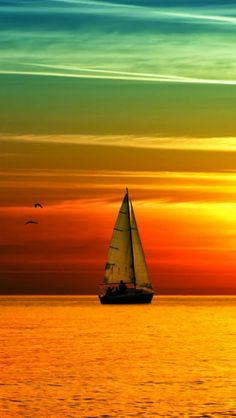 Sailing at Sunset..wow..the colors.