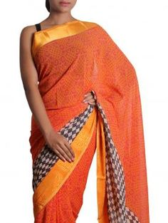 This attractive orange colored georgette saree is a regular wear.The Patch Patti Work beautifully complementing the saree.