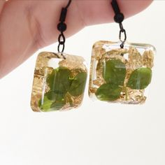 My own work. Resin ear rings with dried cloves and gold flakes.