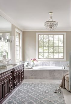 Time to update your master bathroom?  This is lovely - gray paint, crystal chandelier.  House of Turquoise: Minhnuyet Hardy Interiors