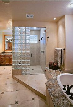 Bathroom with glass block walk in shower and tub
