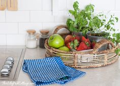 I have a basket like this for my potatoes.should add potted herbs to make it prettier. Summer Home Tour - The Lilypad Cottage Dining Room Blue, Kitchen Dinning, Dining Area, Home Decor Inspiration, Kitchen Inspiration, Kitchen Ideas, Seattle Homes, White Kitchen Decor, Inside Home
