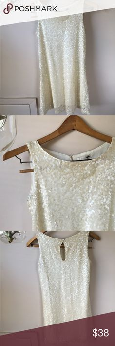 Cream sequin dress by H & M Perfect for a bridal event! Shower/bachelorette/rehearsal dinner/simple wedding. Also great for homecoming or a winter event. So chic with black tights and a headband. H&M Dresses Mini