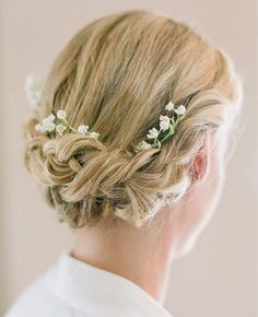 Tuck sprigs of Lily of the Valley into your chignon in lieu of a flower crown  | Brides.com