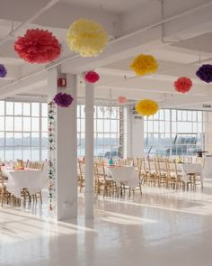 The loft space in the heart of Manhattan offered city views and a blank canvas for décor. In addition to the items brought back from India, the bride incorporated tissue pom poms she found on Etsy.
