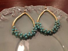 Erin McDermott gold tear drop earrings with turquoise beads delicately attached with wire. Earring hangs about 2 inches.