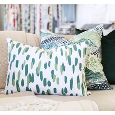 """A fun brush stroked lumbar pillow in an apple green, soft emerald and white. Perfect for quickly adding that perfectly fresh pop to your sofa or bed.Size: 14"""" x 20"""""""