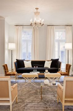 This is the exact layout I need for our living room in the ranch- got all the pieces too...exept for the little benches!    katie lee's manhattan townhouse designed by nate berkus