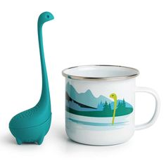 Cup+of+Nessie+Tea+Infuser+&+Cup+-+Time+to+enjoy+a+lovely+cup+of…+wait…+did+something+just+move+in+the+water? For+years,+thousands+have+speculated+the+existence+of+the+Loch+Ness+Monster,+certain+that+there's+an+ancient+aquatic+animal+treading+the+water+of+the+deep,+perilous+loch. But+now+is+the+time+to+put+those+rumours+to+bed,+as+we+can+finally+say+with+some+certainty+that+there+is+nothing+at+the+bottom+of+the+lake…+because+she's+in+your+cup! The+Nessie+Te Latte Cups, Cappuccino Cups, Tea Cup Set, Cup And Saucer Set, Glass Coffee Cups, Royal Tea, Glass Teapot, Tea Infuser, Tea Mugs