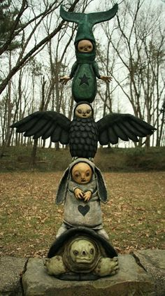 I want to create a totem pole of my totems...but there's just something off-putting about this one LOL ...... Scott Radke totem sculpture