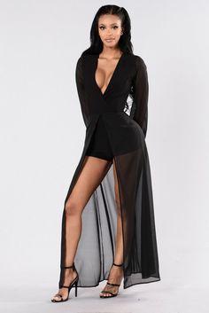 - Available in Black - Romper - Woven Skirt Overlay - Surplice V Neckline - Long Sleeves - Made in USA - 96% Polyester 4% Spandex