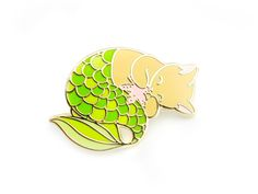 One green purrmaid enamel pin, perfect for mermaid and cat enthusiasts. Collect them all: Pink Purrmaid Blue Purrmaid Green Purrmaid Green Glitter Purrmaid THE NITTY GRITTY ✎ One 1.25-inch (32mm) hard