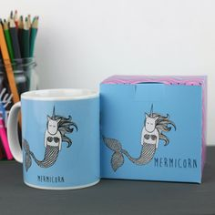 Whats better than a cup of tea? A cup of tea in a mermaid-unicorn mug!  This is a lovely, ceramic mug featuring the legendary Unicorn. It comes with a matching box which makes it a perfect gift for a unicorn lover. The mug is posted by Royal Mail within two days of purchase. This mug has been designed by Neon Magpie.