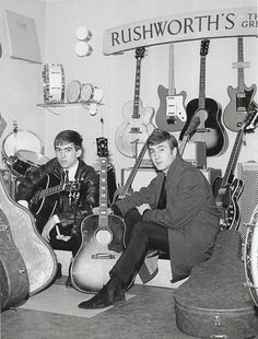 George & John trying out new Gibson guitars at Rushworth's Music House in Liverpool, September 1962