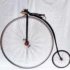 A beautiful Penny Farthing built by Dan Bolwell with copper finish hubs, spoon brake, raw rims and a Gloss Black finish.  www.pennyfarthingdan.com.au