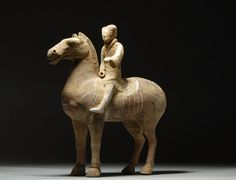 Ancient Chinese Han dynasty Pottery Horse & Rider 200 A.D. love the curves in the horse