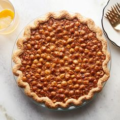 Here's a sophisticated riff on classic pecan pie for chocolate lovers. This pie features a coating of bittersweet chocolate underneath the gooey, espresso-infused hazelnut filling, as well as a delectable topping of crunchy sugar-coated hazelnuts. Chocolate Espresso, Chocolate Lovers, Melting Chocolate, Chocolate Recipes, Cheesecakes, Thanksgiving Cocktails, Thanksgiving Meal, Pie Recipes, Ideas