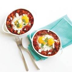 This vegetarian supper puts baked eggs at the center of a cheesy, tomatoey sauce.