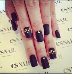 Black matte nail polish with gold arrow and dot detailing. Aboriginal art inspired.
