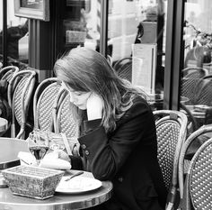 Cafes are a big part of Paris life. Description from…