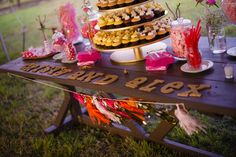 Candy and dessert table with sweets by Sweetness Bakeshop, photo by minervaphotography.com
