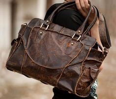 a handmade leather handbag with great worn look
