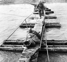 An fallen American soldier, who was killed while crossing a pontoon bridge over the Rur river, Germany, 1945.