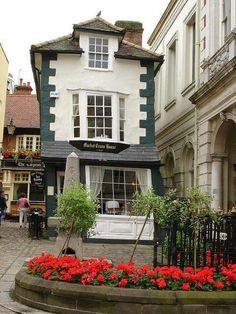 The Crooked House of Windsor, also known as the Market Cross House, was built in 1592. The house didn't start to tilt until 1718 after it was restructured with unseasoned green oak. The building now functions as a tea house for patrons who don't mind sitting at a bit of an angle; the crooked floors were never leveled.