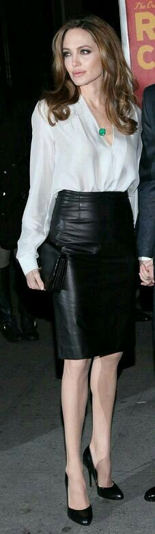 monochrome. black & white. leather skirt. white blouse. green pendant. angelina jolie.