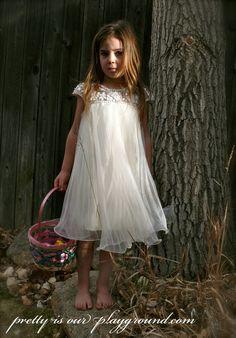 easter egg hunt. little girl in a white dress. perfect for a flower girl