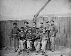 Portrait of a group of Union soldiers serving with the Army of the Cumberland awaiting court martials during the Civil War. Attributed to Mathew Brady. Source.