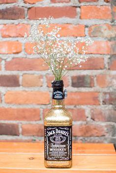 Glamorous Jack Daniel's Bottle Centerpieces | Sara Marie Photography https://www.theknot.com/marketplace/sara-marie-photography-kansas-city-ks-643687