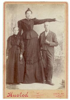 "Miss Ella Kate Ewing.  The tallest woman in the U.S.   8' 4 1/2"".  Size 24 shoe.  Lewis County, MO, Gorin vicinity.  1872-1912."