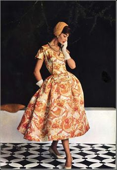 9efbe69773 ... March 1955 (fabric marketed by Bodin) vintage fashion style color photo  print ad model brown tan orange print dress fit flare full skirt day party