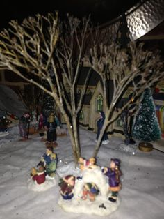 Miniature trees from old dead flowers in the garden stuck in clay worked very well for trees in my Christmas village.
