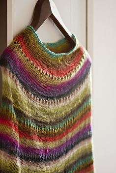 Ravelry: Lilo-'s Feathers. Lace Noro.  Lots of mods on Rav to make this larger, some in worsted too.