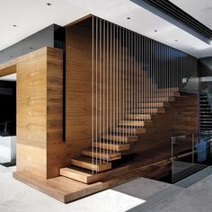 This #Staircase!  / Nettleton 198 #Residence designed by SAOTA / Photo by Adam Letch.  Tag an #Wood lover! #d_signers --- #design #designer #instahome #instadesign #architect #beautiful #home #homedesign #art #luxuryhome #interiordesign #goals #interior #luxury #lighting #decoration #decor #follow #realstate #modern #modernhome #mansion #house #residence #wood #stair