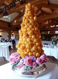croquembouche, the French wedding cake... Seems simple to make and completely gorgeous.... Usually two sparklers placed in it and are lit before serving. I'm kind of loving the idea of having this as our cake and macarons as our favors!