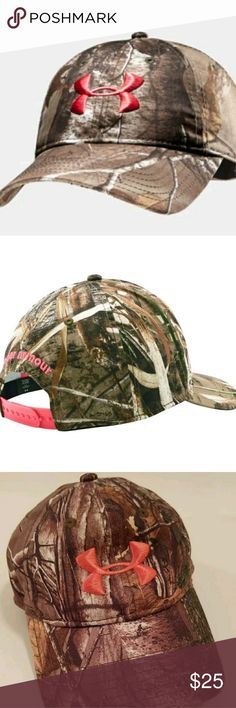 Under Armour Women's Camo Cap (Realtree AP Xtra) 1 This is a really great pre-owned Under Armour Women's Camo Cap (Realtree AP Xtra) 1238981-946. It is in great pre-owned condition. There are no defects to mention. Features include: •Camo cap with ultra-lightweight construction for incredible all-day comfort •Signature Moisture Transport System wicks sweat to keep you dry and light •Built-in internal sweatband •Adjustable snap back closure for custom fit •Embroidered front logo…